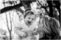 Mom and 1 year old girl laughing